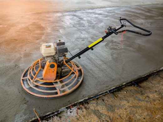 Concrete Floor Polisher running over fresh concrete