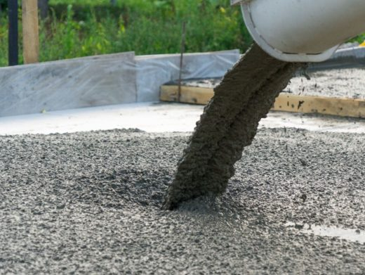 Concrete Truck pouring out concrete